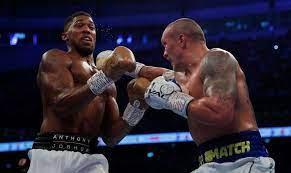 Antony Joshua defeated by Oleksand Usky to claim heavyweight titles
